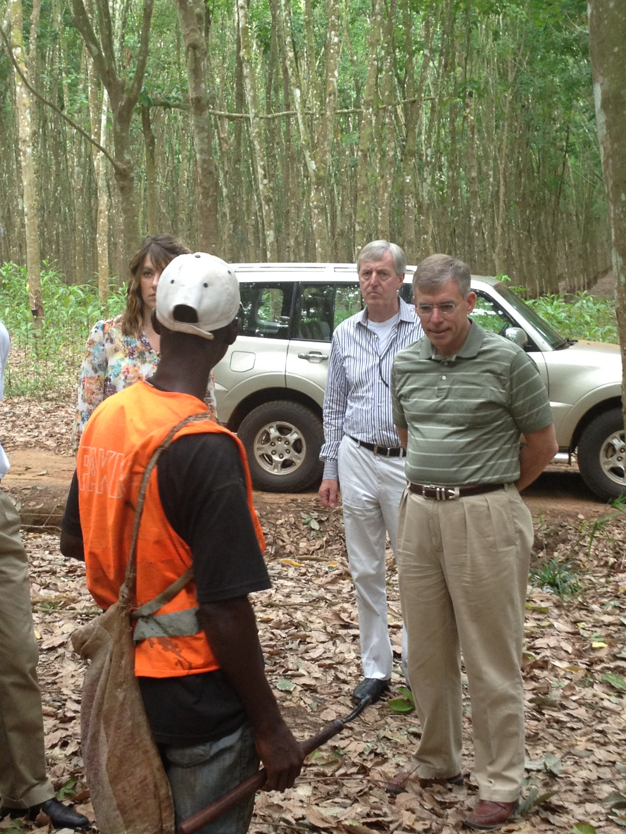 Mary Jones, JB Penn and David Everitt viewing demonstration by rubber tree plantation worker