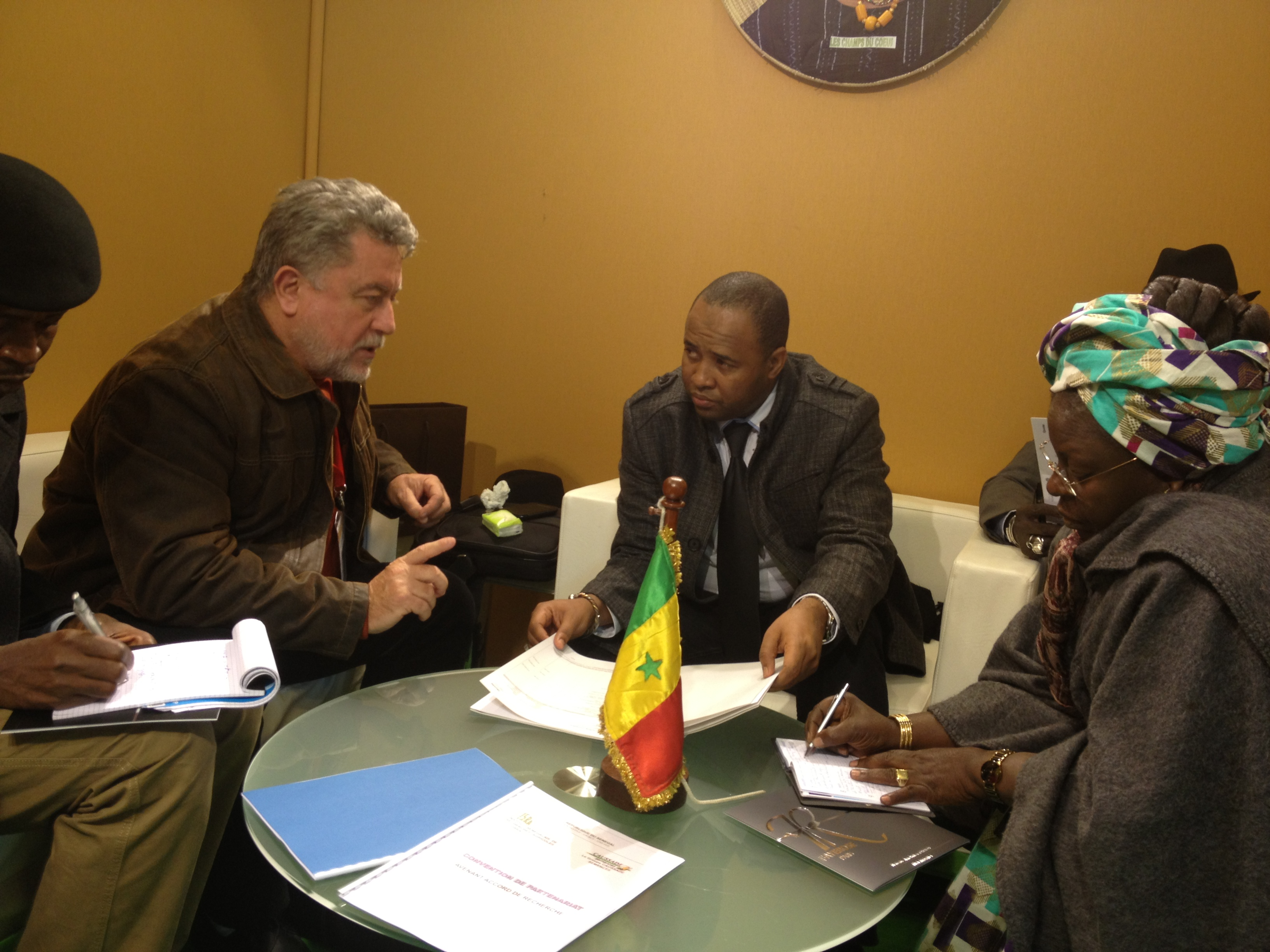 Philippe Remy discusses John Deere products and information with the Senegalese Ag Minister