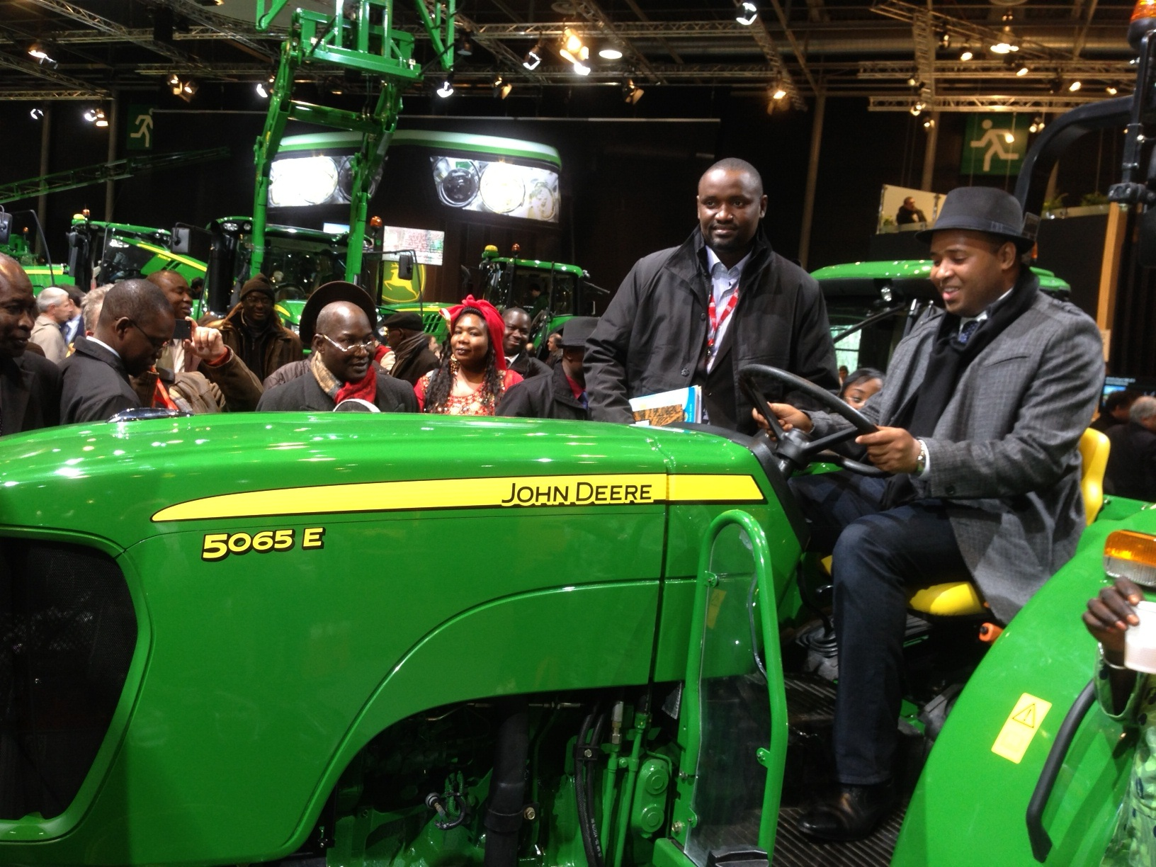 Senegalese Minister of Agriculture, Mr. Abdoulaye Baldé, seated on a John Deere 5065E Tractor.